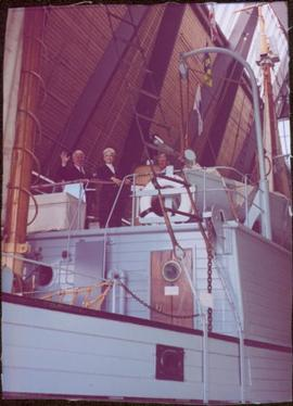 Iona Campagnolo and two unidentified men smile from the top deck of the RCMP St. Roch, Vancouver ...