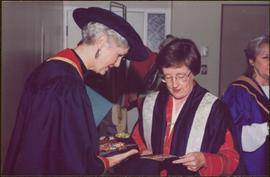 Honourary Doctor of Laws, Brock University - Iona Campagnolo examining the university crest with unidentified woman