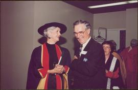 Honourary Doctor of Laws, Brock University - Iona Campagnolo in regalia, smiling with unidentified man