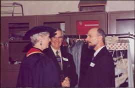 Honourary Doctor of Laws, Brock University - Iona Campagnolo in regalia, speaking with two unidentified men