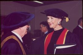 Honourary Doctor of Laws, Brock University - Iona Campagnolo speaking with unidentified man, both in regalia
