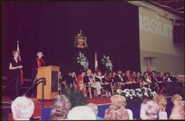 Honourary Doctor of Laws, Brock University - Iona Campagnolo in regalia, speaking at podium onstage