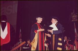 Honourary Doctor of Laws, Brock University - Iona Campagnolo accepting the honorary doctorate degree from an unidentified man