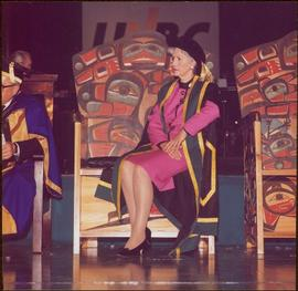 Iona Campagnolo seated onstage on the Chancellor's carved ceremonial chair, in full Chancellor's ...
