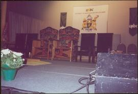 Close view of ceremonial chairs onstage in front of UNBC banners, May 1994