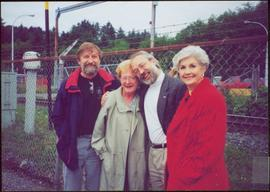 Dennis Macknak, Addie Milewski, Clive Keen and Iona Campagnolo stand together in front of a barbed wire fence