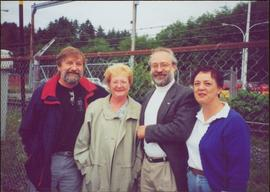 Dennis Macknak, Addie Milewski, Clive Keen and a woman named Kathy stand together in front of a barbed wire fence
