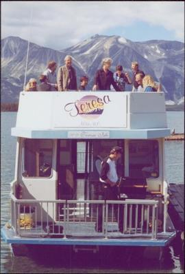 Chancellor's Tour - Iona Campagnolo stands with group on upper deck of the 'Theresa' houseboat in...