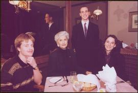 Chancellor's Farewell - Iona Campagnolo sitting at dinner table with 3 unidentified individuals believed to students