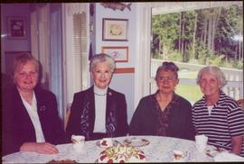 Lieutenant Governor Iona Campagnolo sitting with three women around a table set for tea at Mission, BC