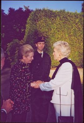 Countess Aline Dobrzensky and Lieutenant Governor Iona Campagnolo shaking hands at Dobrzensky's G...