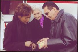 Governor General Michaëlle Jean, Lieutenant Governor Iona Campagnolo, and an unidentified man exa...