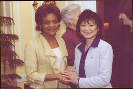 Governor General Michaëlle Jean shaking hands with an unidentified woman wearing a white shirt
