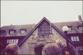 Unidentified man playing bagpipes on the balcony of Government House in Victoria, BC