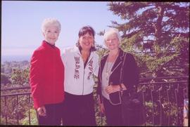 Lieutenant Governor Iona Campagnolo, Dorothy Grant, and Carole Sabiston standing on a balcony