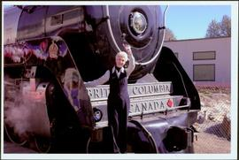 Lieutenant Governor Iona Campagnolo waving from the engine of a train at Stikine Canyon, BC