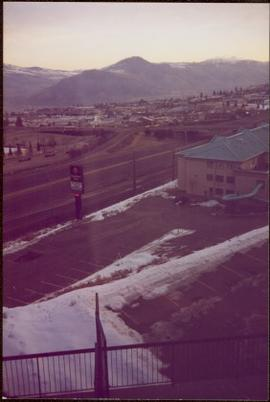 Distance view of an unidentified Comfort Inn with a waterslide; highway, community, and mountains...