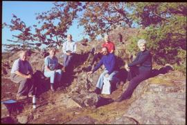 Five gardeners and Iona Campagnolo sitting on rocky outcrop in Terrace Gardens, Government House,...