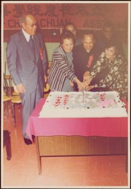 Iona Campagnolo and four others cut a cake at 14th Anniversary of the Tai-Chi Chuan Association