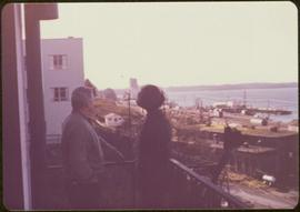 Unidentified man and Iona Campagnolo, overlooking the Prince Rupert harbour from a balcony