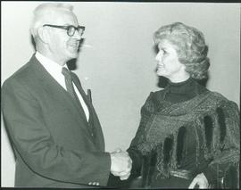 Iona Campagnolo shakes hands with an unidentified man