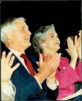 Close view of an unidentified man and Iona Campagnolo clapping