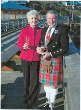 Iona Campagnolo standing on a dock with an unidentified man in formal kilted attire