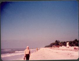 Unidentified man standing on a beach