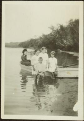 Children with Elderly Woman in Boat