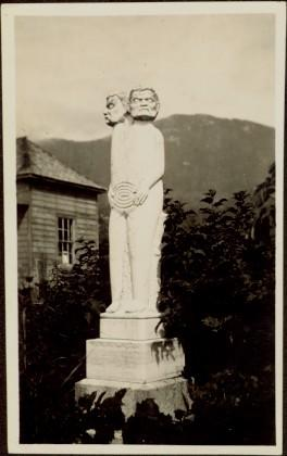 Statue and headstone of grave at Port Simpson, BC
