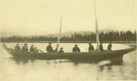 Marion & W.H. Collison in canoe with Tsimshian and Haida crew, travelling from Masset, BC