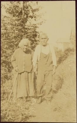 Haida man and woman walking in Masset, Queen Charlotte Islands, BC
