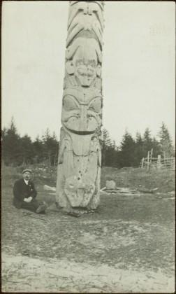 W.E. Collison at totem pole in Masset, Queen Charlotte Islands, BC