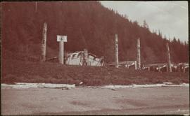 Totem poles and houses at Kaisun, Queen Charlotte Islands, BC