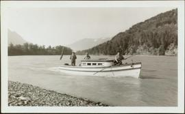 W.E. Collison travelling by boat on business trip up Nass River, BC