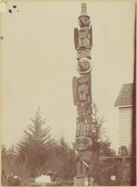 Tlingit totem pole at unidentified house
