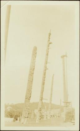 Totem and Mortuary Poles in an unidentified village