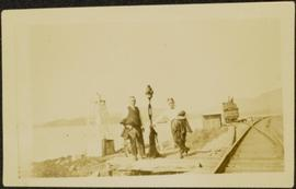 Two Men at Railway Tracks on Shore