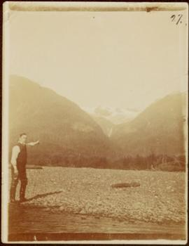W.H. Collison Points to a Mountain Pass