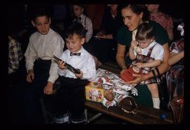 Unidentified woman with children at a hospital Christmas celebration in Nanaimo, BC