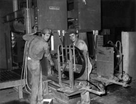 Fernand Lanteigne and Steve Slauko with strapping machine at Clinton Creek mine