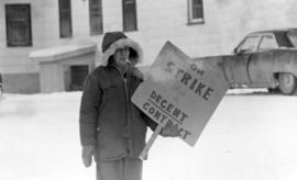 "Worker holding ""On Strike for a Decent Contract"" sign during the 1970 U.S.W.A. Local 65..."