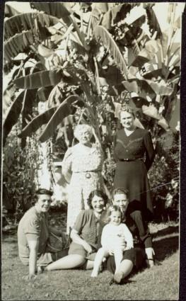 Family Posed near Palm Trees