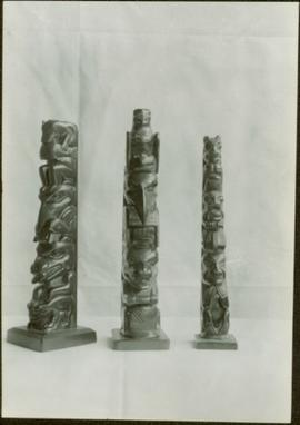 Three argillite totem poles