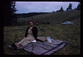 Amy Wilson sitting on blanket during journey to Alkali Lake, BC
