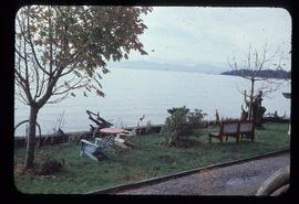 Bench and lawn furniture on shore at Sechelt, BC