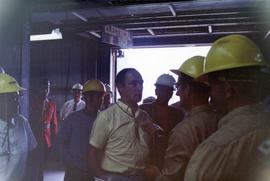 Prime Minister Trudeau speaking with men in hardhats