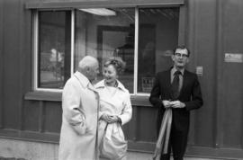 Alice Gritzuk and two unknown men at building dedication