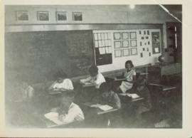 Division II children working at their desks at Giscome School
