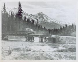 Jeep on Cassiar Road crossing Cottonwood River